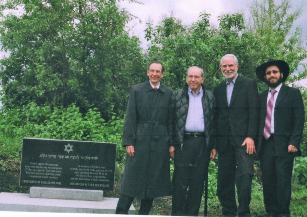 Felshtin memorial dedication ceremony, May, 2010. Standing alongside the memorial, from left to right, Sid Shaievitz, Alan Bernstein, Mel Werbach and Rabbi Yehoshua Raskin.