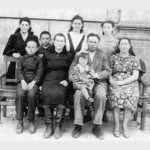 FELSHTIN'S LAST JEWISH FAMILY: Mendel Shvartz and and his wife, Sura Modick, seated, far right. Polina is sitting on Mendel's lap. Polina's sister, Zoya, is standing behind Mendel and Sura. To the left of Mendel is Polina's aunt, Chaika, with her four children, Effin, Sonya, Sergey, and Raisa. Photo 1949. They lived in Gvardeyskoye (formerly Felshtin) until 1970