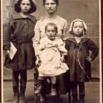 SHIRLEY KELLENSON, FELSHTIN ORPHAN, (standing, with mother and sisters in Felshtin).